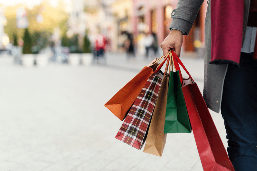 A picture of a person holding shopping bags