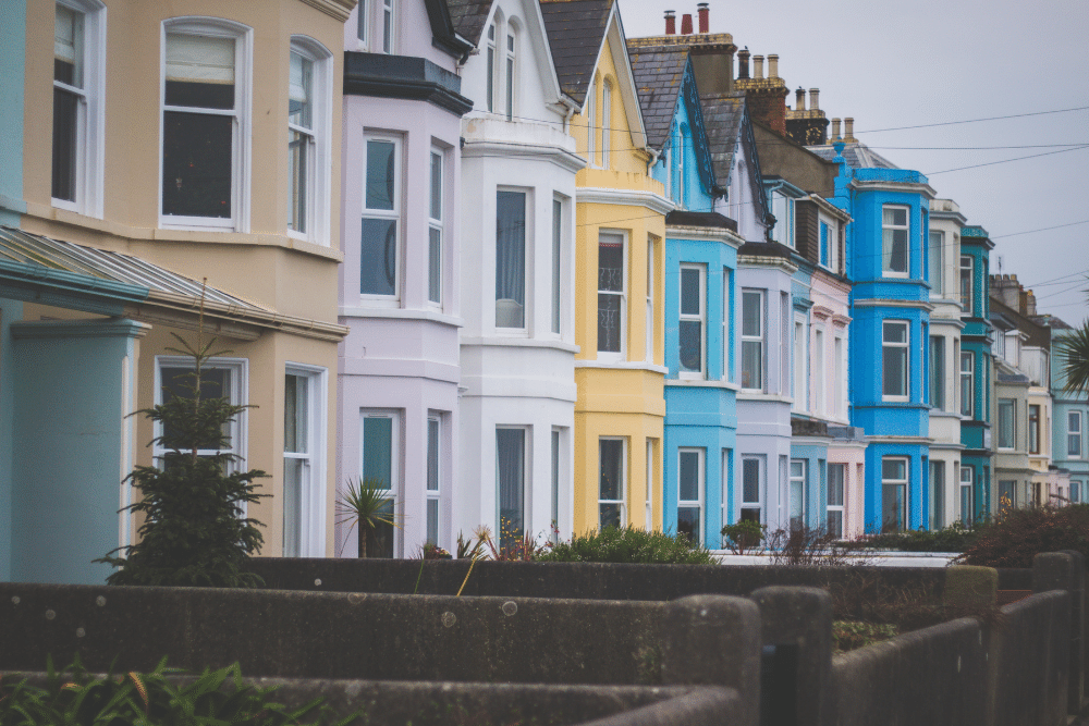 a row of colourful british terrace houses
